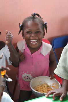 Big smiles from a little girl in Haiti as she's served pasta for lunch from our Food For Kids program: http://goodneighbors.org/food-for-kids