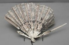 Beautiful old fan.  Lace, and dare I say it ( at the risk of being politically incorrect)  gorgeous ivory