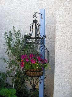 Bird cage with flowers for outdoors...love this!!