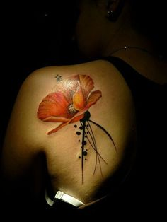 A Water color poppy shoulder tattoo