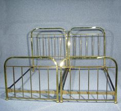 This is a superb quality pair of art Deco brass single beds Wonderful classic simple brass curved top rail to head and foot boards with square brass rails Beds stand on brass bun feet One bed comes complete with slats, second set of slats can be provided at a cost of £10 Extremely strong and sturdy Both beds dismantle for ease of transportation Each bed measures approx 125 cms High {headboard} 86 cms High {foot board} 126 cms Wide 203 cms Length