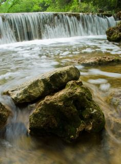 Travertine Creek in the Chickasaw National Recreation Area has many mini waterfalls and beautiful cascades. Hiking, swimming and camping are all popular activities at this Oklahoma outdoor destination.