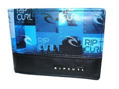 Carteira Rip Curl MONTAGE Azul. Uma carteira jovem com um compartimento para notas, 7 compartimentos para cartões tipo crédito, dos quais um plastificado, 3 compartimentos interiores escondidos e ainda um compartimento com fecho de correr para moedas.