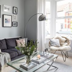Love Scandi style? Then check out this grey living room with all the classic ingredients of a successful Scandi scheme. A cool arc lamp enhances the look #LampBedroom