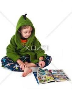 cute boy reading comic book. - Cute boy reading comic book against white background,