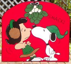 Snoopy Kissing Lucy Under the Mistletoe! Lol! ;)