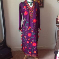 Sassy Embroidered Purple Silk Dress From India Fun, Fun, and more Fun silk, Embroidered Dress from India. Long side slits to be worn with silk pants or tights.  Pom Pom sleeves.  Fun party dress or why not just wear it at home just because, great for entertaining.  Very comfortable.  Can also wear with big jewelry, scarves, or why not a hat?  Size medium or large.  Brand new never worn.  Necklace sold separately.  See closet please. Andaz Dresses