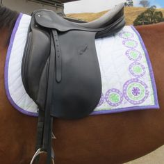 Be Yourself! Exclusive hand batik on this denim dressage saddlepad from Laughing Mare.