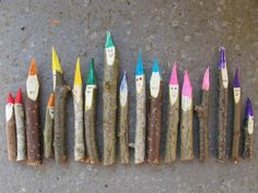 Wooden gnomes. ...sharpened sticks with felt tip drawn hats, pencil drawn faces