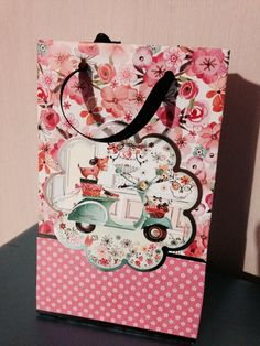 Gift bag made from one sheet of A4 paper. Now I just need to remember how to do it again.........