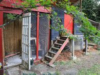 This large coop in East Atlanta is attached to a playhouse and is home to seven chickens.