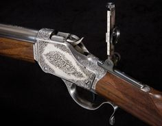 """Magnificently engraved Winchester Model 1885 """"High Wall"""" single shot rifle, designed by Browning when he was only 23 years old. It took the then-popular sport of long-distance """"match shooting""""by storm."""