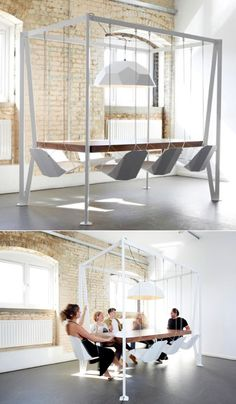 REALLY DULL PIC. BUT IF YOU LOOK CLOSE THE CHAIRS ARE ACTUALLY SWINGS..I LOVE THIS.  I WOULD CHANGE IT UP A BIT , SOME COLOR ? AND NOT BE USING IT FOR MEETINGS...CAN BE A DINING ROOM TABLE OR A GAME ROOM TABLE...Swing meeting table / Christopher Duffy
