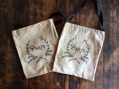 """Primitive 6 1/4"""" x 7 1/2"""" bag made from distressed muslin and printed with a Paris wreath. Comes with a black ribbon for hanging wherever. $6.95 Cdn plus shipping."""