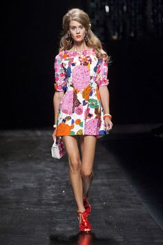 Moschino Spring 2013 And at Moschino, that's never going to be anything other than bold. Florals were big, here, too. Read more: Milan Fashion Week Spring 2013 Runway Looks - Best Spring 2013 Runway Fashion - Harper's BAZAAR Moschino, Runway Fashion, Fashion Show, Fashion Looks, Milan Fashion, High Fashion Dresses, Fashion Outfits, Fashion Clothes, Short Dresses