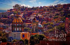 a picture of the monjas church, in san miguel de allende that i photo painted