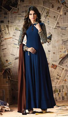 Add a small burst of shade to a wardrobe with this Deep Blue Color Georgette Embroidery Anarkali Style Churidar Kameez. the lovely embroidery work a substantial attribute of this attire.comes with matching dupatta and matching churidar.