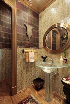 How do you like the bookshelf wallpaper?  For me, this powder room is all about the glass sink.