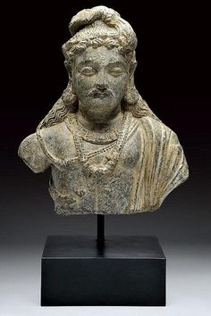 An important Gandhara bust of Maitreya, Afghanistan, 3rd century A.D.