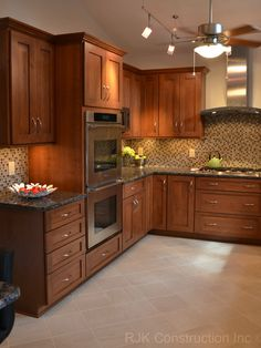Modern Mosaic Backsplash Kitchen, By Designs By SKill, LLC,   http://www.designsbyskill.com/#!home/mainPage,  http://www.facebook.com/DesignsBySKill?fref=ts; LOVE this cabinet color; darker than ours, but not as dark as our floors will be