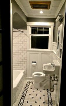 Toilet and sink across from shower. Toilet legroom. Traditional small bathroom.