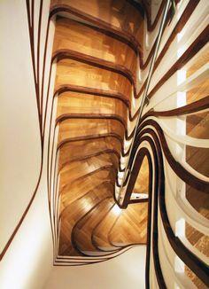 From their website: http://www.fubiz.net/2011/03/08/sculptured-staircase/