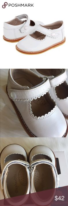 Elephantito White Leather Mary Jane Shoes Create a look of classical sweetness with these adorable Elephantito Mary Janes & I love the sweet button!!  Premium leather upper with scalloped edging. Padded collar provides additional comfort. Hook-and-loop closure for an adjustable and secure fit. Breathable leather lining and a cushioned leather footbed. Durable rubber outsole. Size 5. Previously loved. Only flaw is shown in photo. Comes with box, but the plastic is gone on the screen…