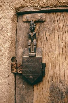 Africa | Details of a granary door lock.  Dogon Country, Mali | Image ©Michel Renaudeau