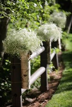 At the front of the ceremony site, baby's breath will gently fall off the banisters framing the altar.
