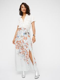 Bri Bri Butterfly Maxi | Super soft and lightweight maxi skirt featuring a floral and butterfly print. Side slit detailing and an adjustable waist belt. Lined with a half-slip.