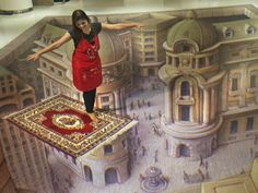 A woman stands on a 3-D painting at the Trick Art exhibition Dec. 17 in Jakarta, Indonesia.