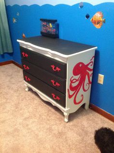 Brandon's updated dresser. I painted the octopus on the side and painted the handles to match. This is for this under the sea ocean bedroom.