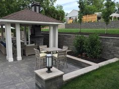 Bigger Backyard enjoyment after Allan Block Retaining Walls was used to expanded the patio.