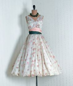 I want a reason to wear this dress! Love 50's dresses!
