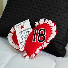Give your star some back to school love with this heart shaped no-sew felt team spirit pillow finished with your own personalized note.