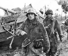 Grenadiers of the Herman Goering Division walk past a damaged Elephant tank destroyer, belonging to 653. Battallion, near the Italian town of Nettuno, March 20, 1944.