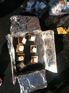 SOLAR SMORES - there are more elegant boxes than mine that actually direct the reflected light onto the smores. But just the heat of the black paper and the hot sun worked well enough for the kids to get that heat energy cooks our food and changes the state of matter. #preschool #science #matter #energy #heat