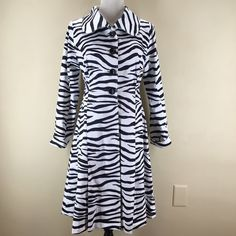 "Monroe & Main Zebra Print Trench Coat Zebra print trench coat. Four button front close, side pockets and only lined on top so bottom is light and flares out! Stylish and comfortable  Fitted at waist. Waist size, 33-34"" (waist is 15 inches below shoulder). Bust size, 35-36"". Sleeve length, rolled-22 1/2"" unrolled-25"". Shoulder to shoulder back width, 14 1/2"". Center back length, 38"". 97% Cotton 3% Spandex. Lining 100% Polyester. Machine wash. Monroe & Main Jackets & Coats Trench Coats"