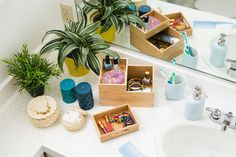 Bathroom counter done right! Organize makeup and accessories with these wooden DRAGAN boxes.