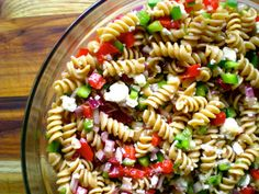 Pasta Salad with feta cheese, fresh peppers, onion, red wine vinegar, and heart-healthy olive oil. Quick, easy, and perfect for picnics! SimplePairings.com