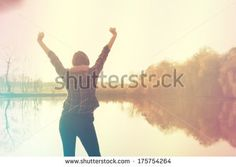Retro photo of young woman with arms raised by Balazs Kovacs Images, via Shutterstock