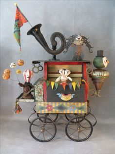 """Traveling Show"".  Recycled artwork by Leona Keene Sewitsky."