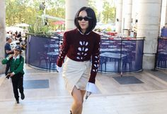 Yoyo Cao in Gucci sunglasses and Isabel Marant sweater and skirt