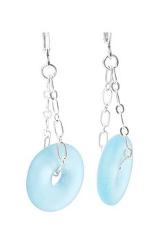 The repurposed glass on these earrings are from reclaimed Miniature Bombay Sapphire Gin bottles. The lightweight blue glass has been tumbled creating a sea glass finish. The entire earring, from the top of the lever back to the bottom of the blue glass, is approximately 2.5″ in length.