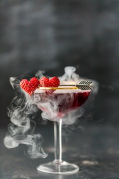 This Pomegranate Martini is the perfect Valentine's Day cocktail! It's a tasty triple berry martini with strawberry vodka, Chambord black raspberry liqueur, and pomegranate juice. Plus there's a little dry ice trick to really put Dry Ice Drinks, Valentine's Day Drinks, Pink Drinks, Party Drinks, Cocktail Drinks, Yummy Drinks, Cocktail Recipes, Beverages, Cocktail Shaker