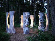 'The Sentinels' by Brent Comber (on Salt Spring Island, B.) Huge carved illuminated maple slabs conceived as a circle of elders. Supposed to be an unreal experience in person and at night! Outdoor Tree Lighting, Outdoor Trees, Outdoor Sculpture, Wood Sculpture, Garden Sculpture, Artist And Craftsman, Wooden Art, Environmental Art, Installation Art