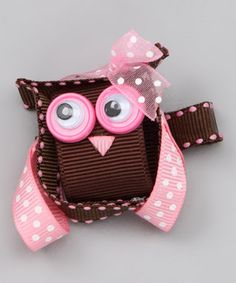 """Ever look at something and think, """"I can do that.""""  An owl clip that looks like it's made mainly with ribbons and googily  eyes."""