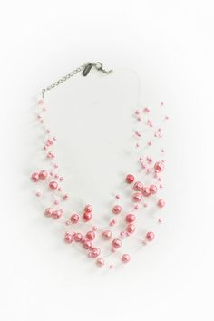 Dressing Your Truth - Type 1 Scattered Pearls Necklace Pink -  Random sized pearls are strung along nylon threads for a dancing and light look and feel.        16 inches, adjustable      Trigger Clasp