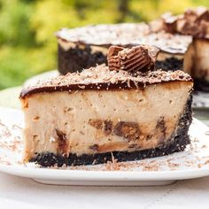 Reese's Peanut Butter Cheesecake Recipe w Oreo crust - a creamy, dreamy, decadent cheesecake recipe perfect for a celebratory occasion! Worth every calorie.
