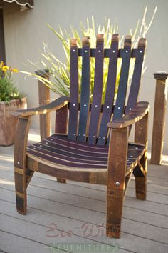 "Wine Barrel Furniture Chair The Demonte Chair has a solid, sturdy design with wide armrests. Handcrafted from wine barrel staves for years of comfort and enjoyment. Dimensions: 45""H x 26.5""W x 17.75""D"
